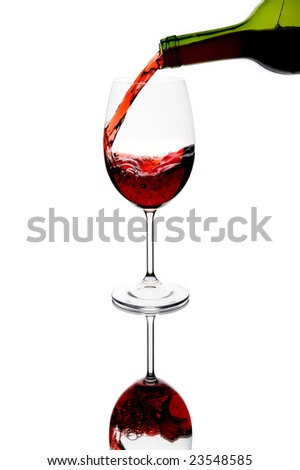 Red wine being poured into glass - stock photo