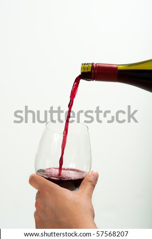 Red Wine Being Pouring Down into Glass