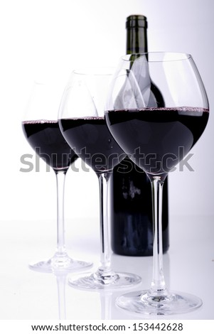 Red Wine bottle and glass on white background - stock photo