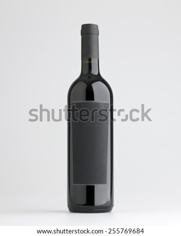 red wine bottle with label  - stock photo