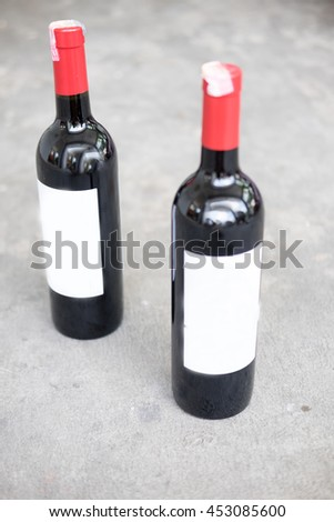 Red wine bottle with real paper blank label - stock photo