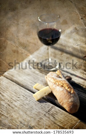 Red Wine, bread and cheese on the wooden table