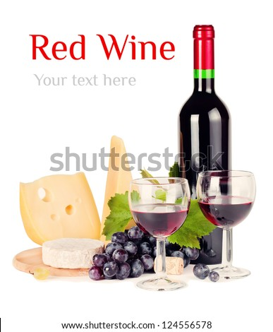 Red wine by the glass and a variety of cheeses - stock photo