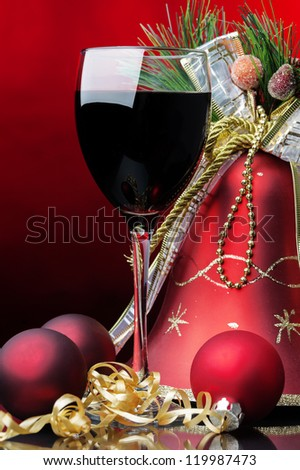 red wine Christmas decoration at red background