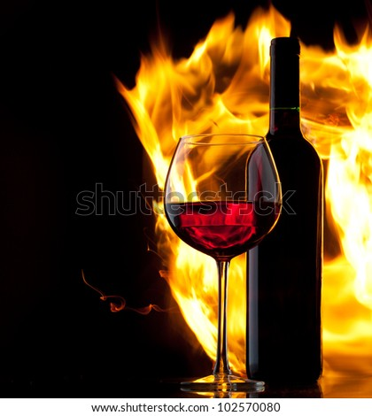 Red wine. Concept with fire. - stock photo