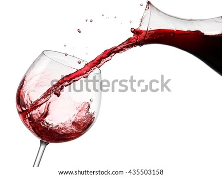 Red wine flow in a glass from a decanter - stock photo
