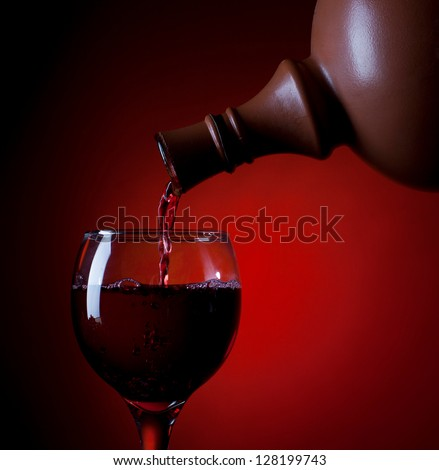 Red wine flowed in a glass