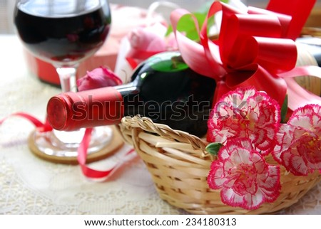 red wine for party with carnation flowers