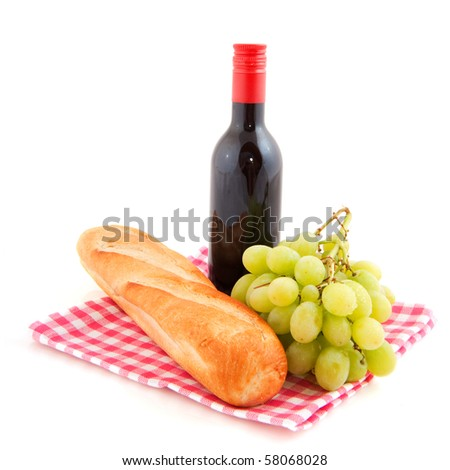 Red wine, French bread and white grapes for the picnic