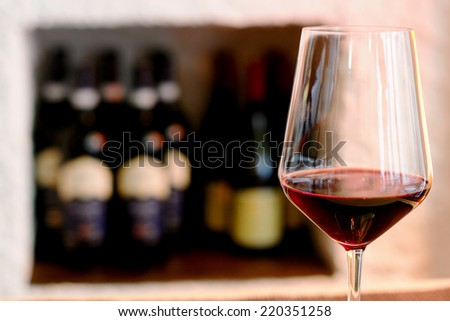 red wine glass against  - stock photo