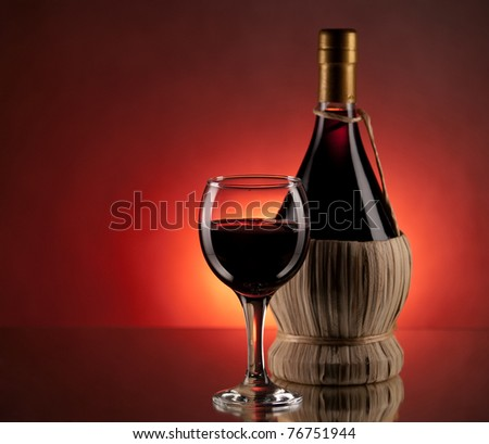 Red wine, glass and bottle - stock photo