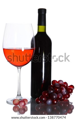 Red wine glass and bottle of wine isolated on white