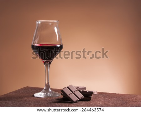 Red wine glass and chocolate - stock photo