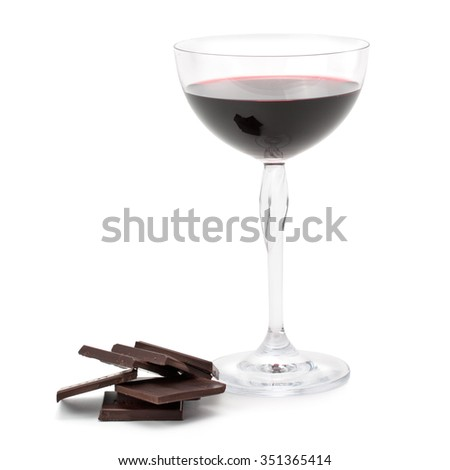 Red wine glass and dark chocolate isolated on white background - stock photo