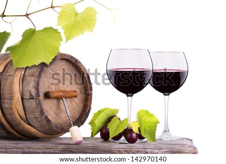 Red wine, glass barrel with grapes and corkscrew over white - stock photo