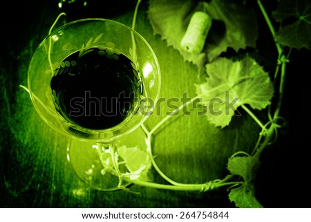 red wine glass isolated on wood background - stock photo