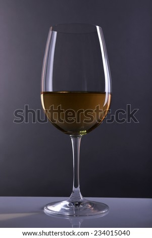 Red wine glass of wine on grey background