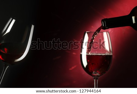 red wine glass on red background