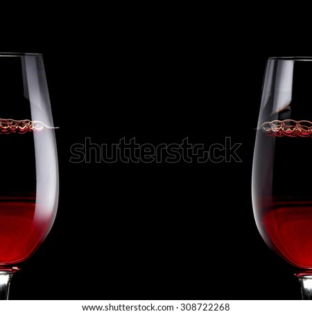 Red Wine Glass silhouette on Black Background with Bubbles - stock photo