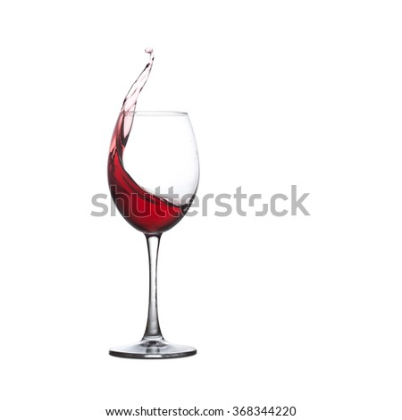 Red wine glass. Splashing red drink, white background. copy space.