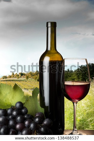 red wine glass with grape