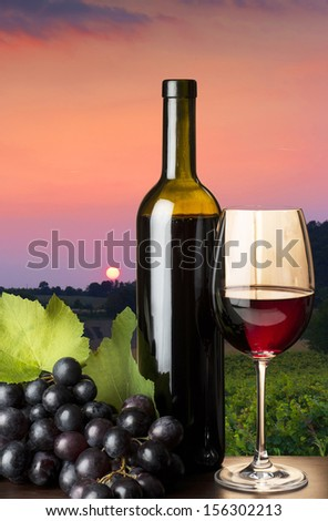 red wine glass with grapes