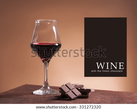 Red wine glass with the finest chocolate - stock photo