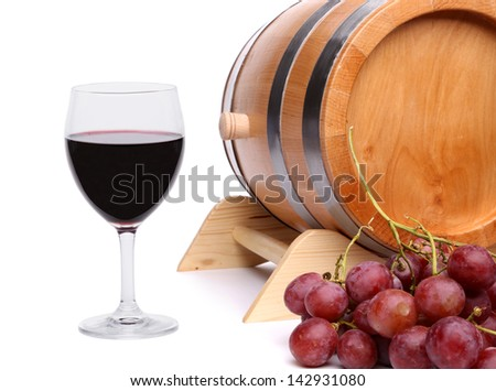 Red wine, grapes and old barrel