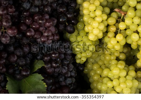 Red wine grapes, low light in the market.