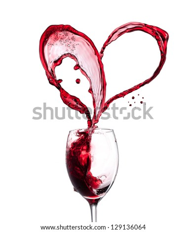 Red wine heart over white background - stock photo