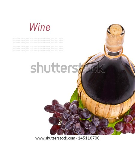 red wine in a pot-bellied bottle with a wicker basket and grapes with drops of water isolated on white background - stock photo