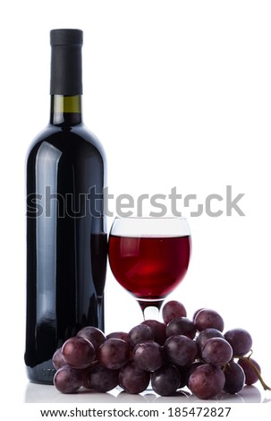 Red wine in glass, bottle and grapes isolated on white backround