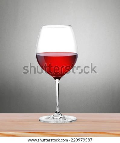 Red Wine in glass on light background