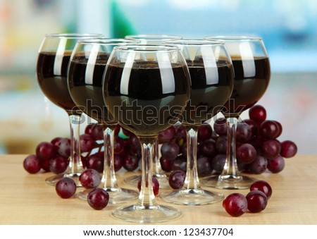 Red wine in glass on room background - stock photo
