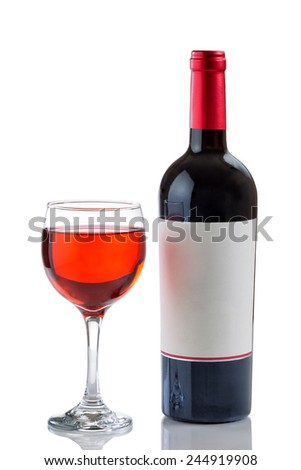 Red wine in glass with full bottle on side isolated on white background with reflection  - stock photo