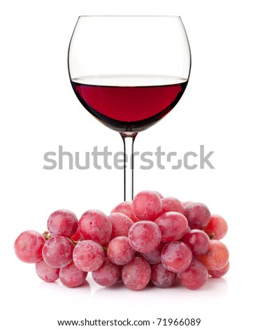 Red wine in glass with red grape branch. Isolated on white background - stock photo