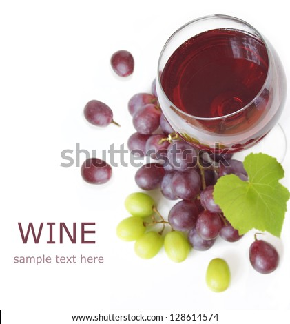 Red wine in glass with res and white grapes and fresh green grapes leaf isolated on white with sample text - stock photo