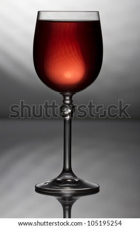 Red wine in grey background