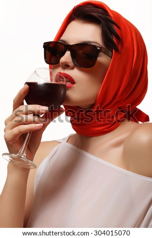 Red wine in the glass, beautiful and sexy woman drinking wine - stock photo