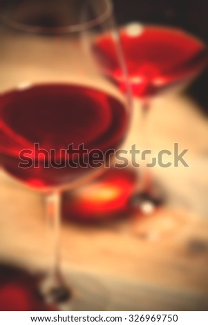 red wine in two goblets. romantic blur still life. instagram image filter retro style