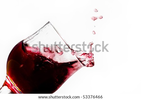 Red wine into glass - stock photo