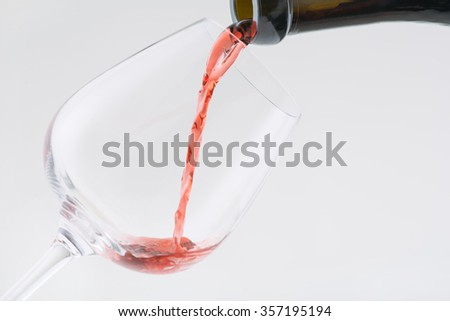 Red wine. Nice red wine is being poured in transparent glass.  - stock photo