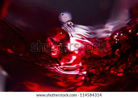 Red wine on a black background , abstract splashing. - stock photo