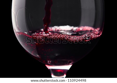Red wine on a black background ,saved clipping path. - stock photo
