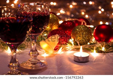 Red wine, ornaments and candles as a New Year decoration, New Year decorations, photography