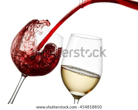 Red wine pour and a white wine glass - stock photo