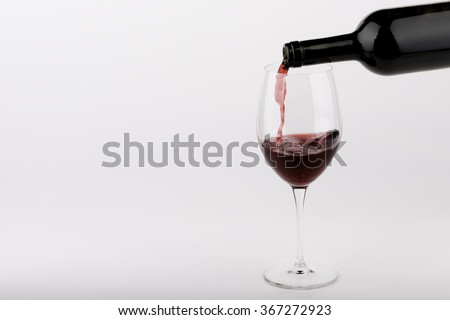 red wine poured by bottle