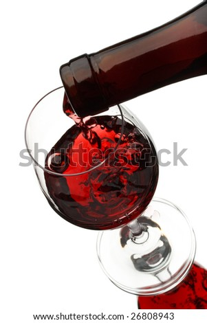 Red wine poured in a glass isolated on a white background