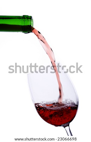 Red wine poured in a wineglass isolated on white background