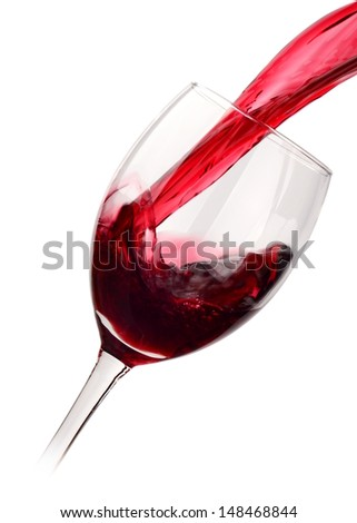 Red wine poured into a glass isolated on white - stock photo